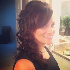 Bridesmaid hair. Half pinned up, with poof. Loose curls flowing to the side. A few pins to hold in place.