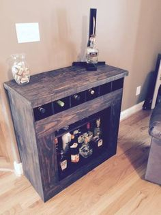 Liquor Cabinet Custom made liquor cabinet using pallet wood and finished with a Kona stain.