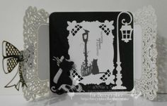 Card with doily and cat silhouette