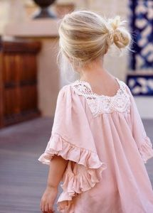 Such a cute little girl's dress and perfect little side-bun