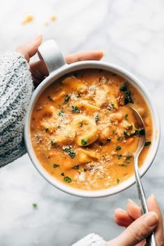 Creamy tortellini soup in a bowl.