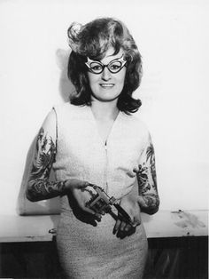 The pouffy hair, the nana glasses and the tatts, just aren't going together for me...