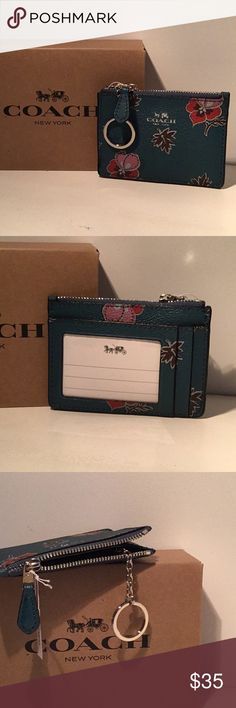Coach ID key ring ID cases Great gift!!! Coach mini ID case with key chain to hold your keys, money, credit card and loose change. Teal color with red, pink and brown with silver lettering and hardware. Coach Accessories Key & Card Holders