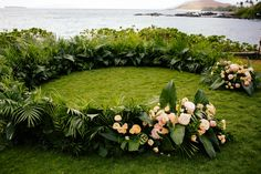 Ashley and Micheal didn't want to block the gorgeous view of the ocean so Wildheart Florals created a semi circle floral piece that came a few feet off the ground.