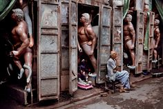 Steve McCurry, INDIA. Allahabad. January, 2001. A man sitting in front of statues.
