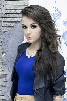 Cher Lloyd she definetly pulls off shaving one side of her hair!!! i love her hair