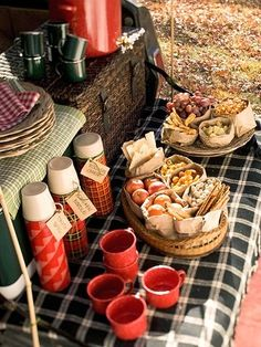 Thermoses are another must-have for fall picnics.  Use them to transport cider and hot beverages or soups, like in the photo above!  You can bring several different kinds with cute cups for serving!  Add some finger foods and mini sandwiches and your entire meal is ready for the crowd!