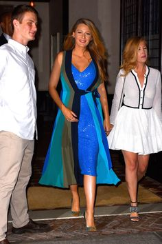 Blake Lively in a Diane von Furstenberg blue sequined wrap dress, Christian Louboutin heels, and Ofira and Lorraine Schwartz jewelry while out in New York City.