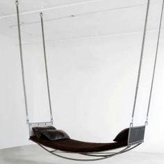 A hammock created out of rich, luxe materials. Leather, steel, shearing and felt all combined for a unique suspended seat.