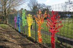 """Rainbow trees using upcycled plastic   Anya Beaumont """"Recently I worked with children from a local primary school to create this beautiful installation of rainbow trees. Initially I asked the children and staff to bring in any non-recyclable plastics they had at home or in school.... I talked to the children about the importance of thinking about what happens to an object after it has been used, and whether we really need many of the plastic items that seem to break so easily. We also…"""