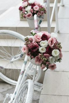 A bike painted white is the perfect canvas for any wedding style!