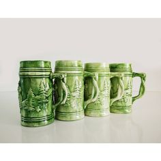 Vintage Green Ceramic Mugs, set of 4, Beer steins ($35) ❤ liked on Polyvore featuring home, kitchen & dining, drinkware, ceramic beer stein, holiday tree, ceramic tree, tree mug and green mugs