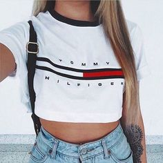 Knit crop top in black and red logo - ringer tee Cuffed sleeve Cotton with a soft touch  Small and medium -please pick Small is 14 inches long Medium is 15 inches long  Ready to ship All sales final