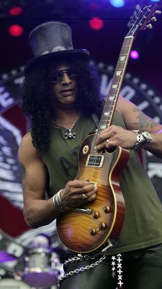 "AP PhotoVelvet Revolver and former Guns N' Roses guitarist Slash is one of several musicians featured in ""Guitar Hero III."" ""Guitar Hero III: Legends of Rock"" will arrive in stores Sunday and offer video game fans the opportunity to jam. Music Love, Music Is Life, Rock Music, Heavy Metal, Heavy Rock, Axl Rose, Banda Guns N Roses, Motif Music, Rock And Roll"