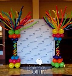 Rainbow balloon columns on the sides of a step and repeat photo area. The balloons will bring more attention to the photo op, which brings more attention to your brand! Balloon Columns, Balloon Arch, The Balloon, Balloon Centerpieces, Balloon Decorations, Balloon Ideas, Its A Boy Balloons, Rainbow Balloons, Customer Appreciation Day