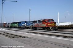 ATSF #150 East (EMD GP60M) leads an autorack train through San Bernardino, CA in September 1996.  Photo by David Greenberg.
