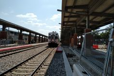 Platform Construction Work and a Southbound Trinity Railway Express Train doing station work at Fort Worth