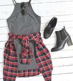 grey thin strap tank dress with plaid or checkered collared button up shirt tied around waist, black ankle boots, and black sunglasses.