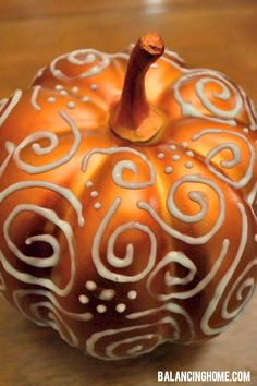 Halloween pumpkin idea: Use a puffy paint pen that glows in the dark. The result is great!