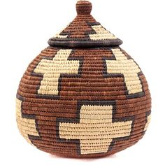 "Approximately 8"" Tall x 7"" Across  To create this traditional basket, weavers use strips of naturally waxy palm fronds wrapped around coils of wild grasses. Some baskets are still used for liquid storage in the rural areas of South Africa. Watertight baskets are readied by rubbing wet cornmeal inside. When liquid is added, the coils swell. Some leaks through, evaporates, and cools the contents.  Designs carry cultural significance and many large baskets are traditionally given at weddings…"