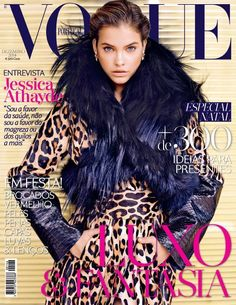 Gracing the December 2014 cover from Vogue Portugal, Barbara Palvin looks prepared for winter in an animal print jacket trimmed with black fur and featurin