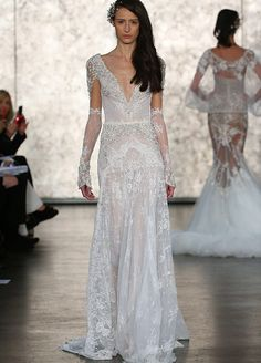 You'll feel like a queen in this stunning Inbal Dror wedding dress with an embellished plunging neckline and sheer sleeves.