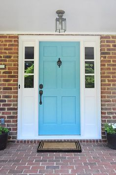 If there's one place where you can play with color on the outside of your home without feeling like you're forcing Key West in the Midwest, it's the front door.