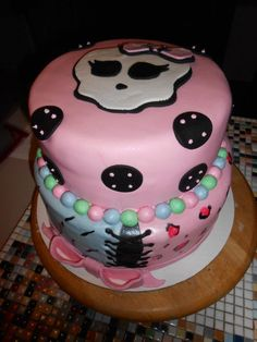Love the soft and girly colors used on this Monster High cake.