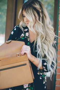 stunning long blonde ashy platinum hair with a dark root - love this look for spring.