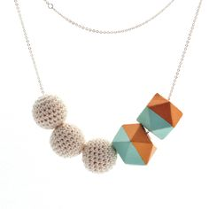 Necklace Nice 5 by Mon Bijou - French Jewellery, a stylish 'composition' of ivory coloured round crochet cotton beads with hand painted gold and turquoise faceted geometric wood beads on a silver-tone adjustable brass chain. Nice or Nizza is located on the south east coast of France, also known as the Côte d'Azur. Nice is affectionately called 'Nice la Belle', which means 'Nice the Beautiful'. For centuries the English upper class loved Nice for its natural beauty its mild Mediterranean…