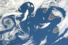 The Canary Islands. And some really cool cloud patterns. Taken July 6, 2013.  KN from space.