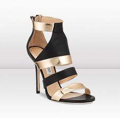 Besso by Jimmy Choo - contemporary transitional sandals alternate contrasting the chunky straps of black vachetta leather with gold mirror leather