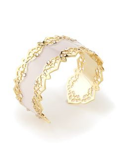 Gold tone brass and white enamel cuff bracelet with cut out details and clear crystal accents    2½ inches in diameter  1½ inches wide  By LK Jewelry on Gilt.com