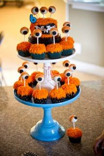 This idea is so cute for a first birthday! That way the baby can have the personal cake at the top and everyone else can have a cupcake