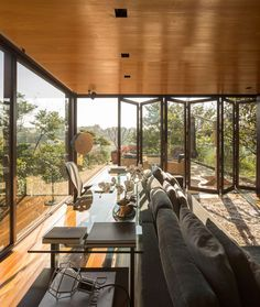 Folding glass doors can be opened to expand the living and games area of this home.