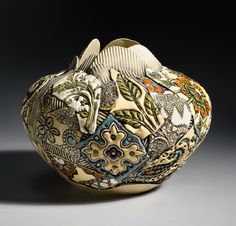 Large Round Vessel by Gail Markiewicz. Hand built of textured and carved clay in a patchwork design. Airbrushed and hand painted with glazes. Each piece is unique. Exact patterning and coloration will vary. Pottery Sculpture, Sculpture Clay, Pottery Vase, Ceramic Pottery, Ceramic Sculptures, Porcelain Ceramics, Ceramic Bowls, China Porcelain, Painted Ceramics