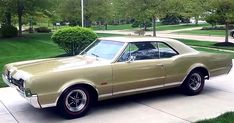 This is a stunning 1967 Oldsmobile Cutlass Supreme 442 Holiday hardtop Coupe in Gold (G code) with black Morocceen vinyl upholstery interior