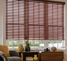 I've been trying to decide what window treatments I should use in our office, and I came across this. Blinds are a convenient way to filter out the amount of light you want. I also really love the dark wood look of these, and they would look perfect in there!