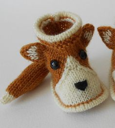 Free Knitting Pattern for Fox Baby Booties - These Chaussons renard baby shoes by Thali Créations come in sizes 0/3 mos, 3/6 mos and 6/9 mos. At the destination page scroll down to get the English patterns. Note that the original language of the pattern is French so the English translation isn't perfect but there are links to picture tutorials.