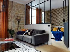 Small apartment with stone wall and glass door in Paris - Loft Style - Door Design Small Apartments, House Design, Interior, Apartment Design, Loft Style, Home Decor, House Interior, Home Deco, Apartment Interior