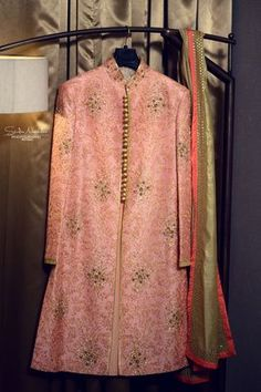 Groom Wear - Light Pink Sherwani with gold scattered motifs and olive green dupatta | WedMeGood #wedmegood #sherwani #pink #groomwear