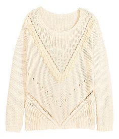 25 Textured-knit sweater in a thick cotton blend with a perforated pattern at front, decorative fringe, and long sleeves.