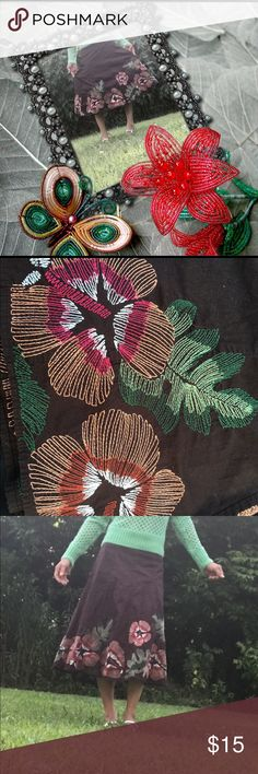 Full Length Skirt Color is solid brown with floral designs at the bottom. It's a full length skirt measuring 27 inches in length. The tag says women's size 2. The waist line fitting the skirt as shown measures 28 inches. Back zipper made into seem to be non noticeable. New item without tags. Excellent condition! S.L.B Skirts A-Line or Full