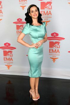 Katy poses in a Zac Posen resort dress with a Dolce & Gabbana headband at the MTV EMAs in Amsterdam.