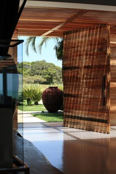 CASA TRANCOSO – BAHIA, large wood gate & fence for an impressive entrance, large pots, enticing path.