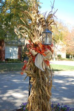Fall outside decoration. Corn stalk over the shepards hook with a lantern. Fall outside decoration. Corn stalk over the shepards hook with a lantern. Thanksgiving Decorations, Halloween Decorations, Thanksgiving Tablescapes, Thanksgiving Holiday, Hallowen Ideas, Outside Decorations, Outside Fall Decorations, Harvest Decorations, Autumn Decorating