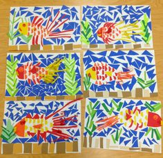 Art with Mr. Giannetto: 2nd Grade Fish Mosaics. By cutting and gluing various paper shapes and sizes the students created an underwater scene. They created a 3-D effect by manipulating the paper through folding and curling different parts of the fish.