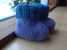 Baby boots, knitted and felted wool.