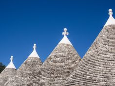 TweetPuglia's most iconic image is the trulli, unique huts with conical roofs that you find scattered amongst the olive groves all over the Valle d'Itria in southern Italy. These strange limestone dwellings look like somewhere a hobbit might reside and there's nothing else like them anywhere in the world.  The trulli are built using drywall construction, a prehistoric building technique that is still used in the region today. Instead of using mortar the stones are layered on top of each ...