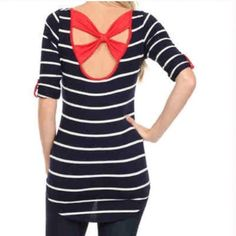 Navy and White Striped Tee with Red Bow Back Give nautical stripes your own twist! This blue and white striped tee has a hi-low hem and 3/4 length sleeves. There is red trim along the scoop neck. The back has a striking red bow detail. Also available in small and large (see separate listings). Boutique Tops
